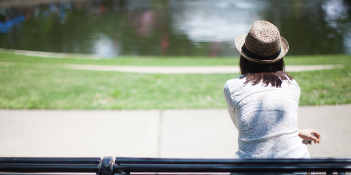 Woman resting on park bench