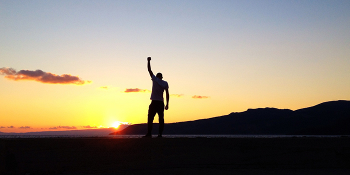 Man standing with fist in the air