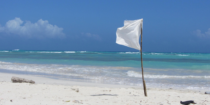 Surrender flag on beach