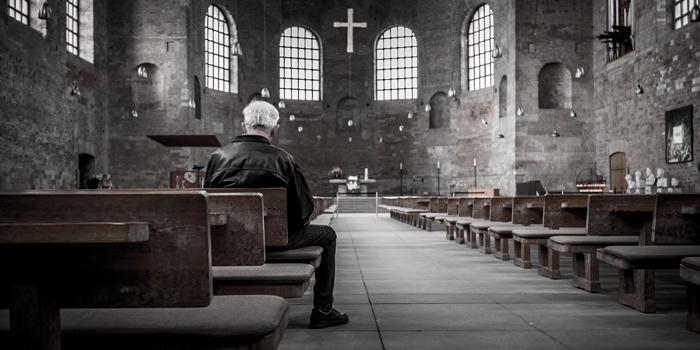 Man sitting inside of church
