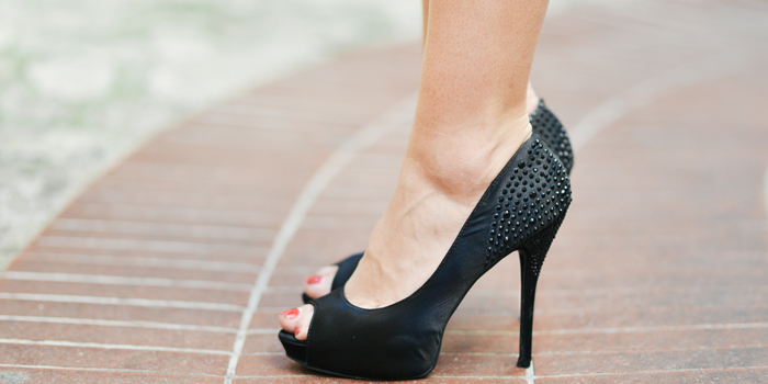 Woman standing with high heels