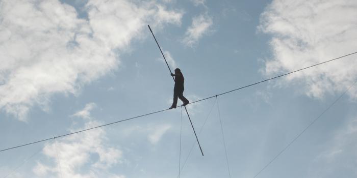 Man balancing on highwire