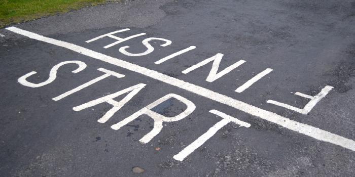 Start and finish written on pavement