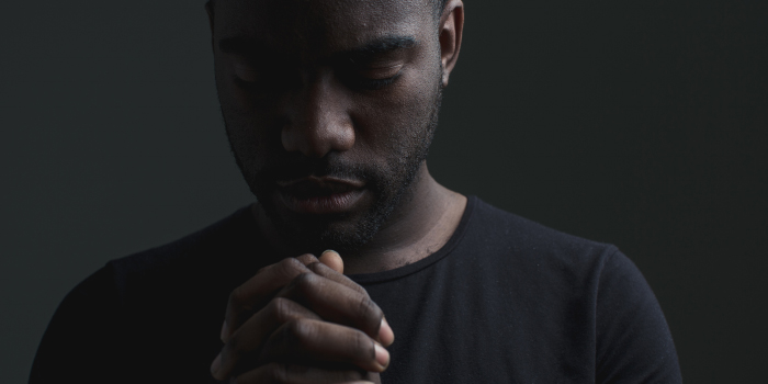 Man with eyes closed and praying