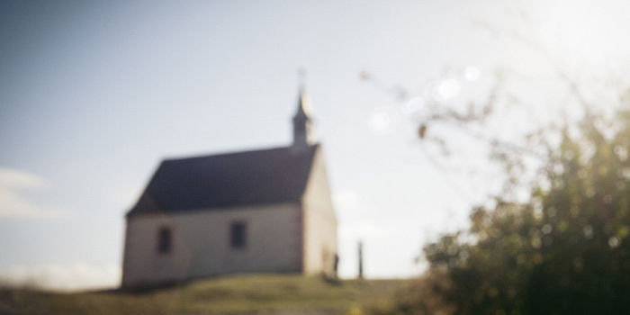 Blurred image of a church on a hill
