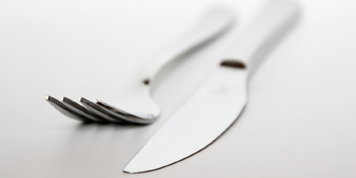 Fork and knife laying on a table