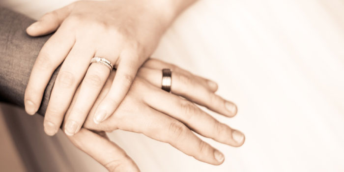 Close-up on hands of married couple