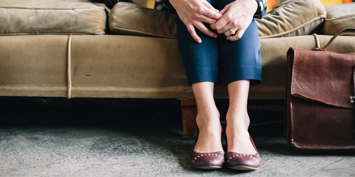 Woman's feet at the edge of the couch