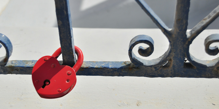 Heart shaped padlock on gate