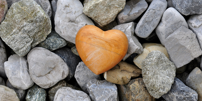 Wooden heart on top of rocks