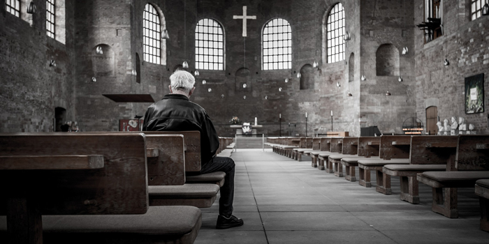 Man sitting inside of church
