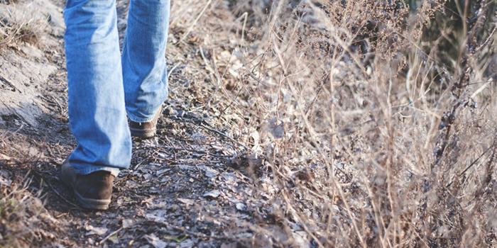 Man walking down beaten path