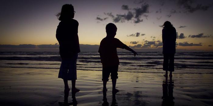 Children standing on the seashore