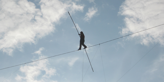 Man balancing on highwire