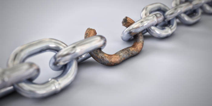 Chains with one rusty broken chain link