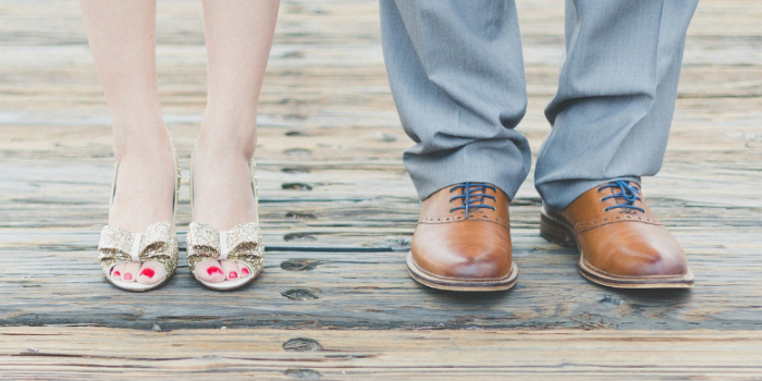 Closeup on the feet of a husband and wife standing next to each other