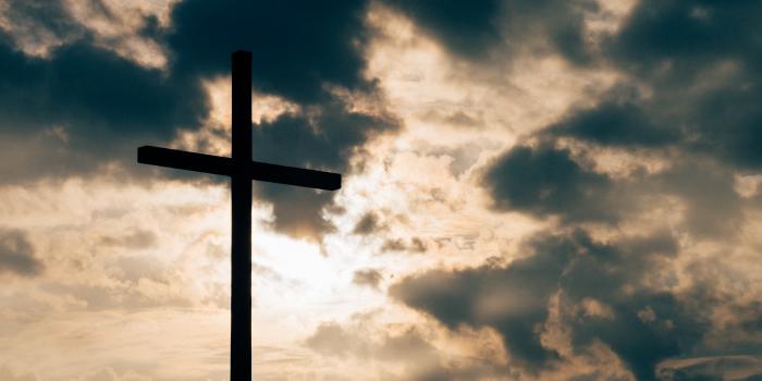 Cross over a darkened sky