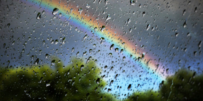 Blurred image of a rainbow through a window