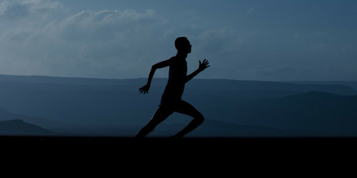 Silhouette of man running early in the morning
