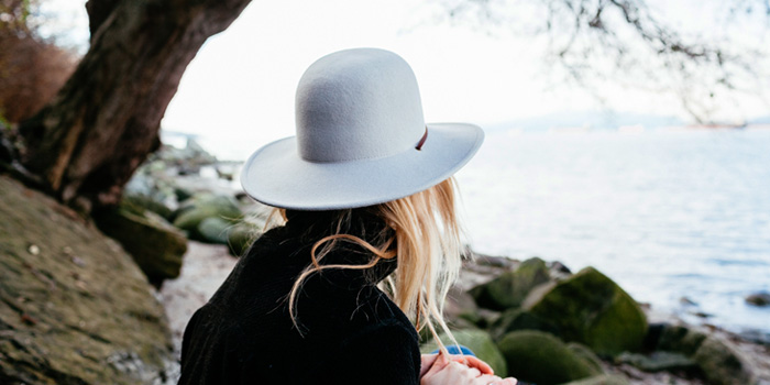 Woman wearing a white hat looking out to the horizon