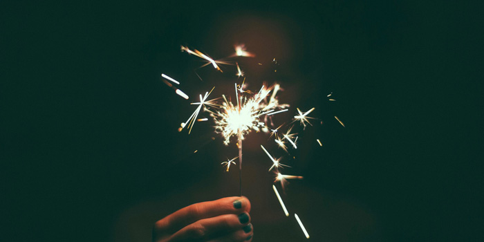 Closeup on a hand holding a sparkler