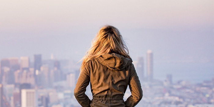 Woman staring out towards city