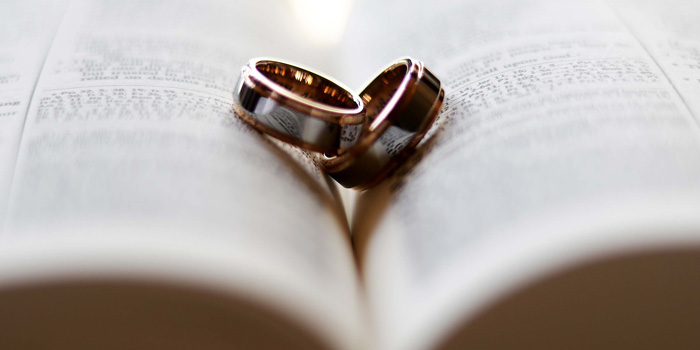Wedding bands sitting on the Bible