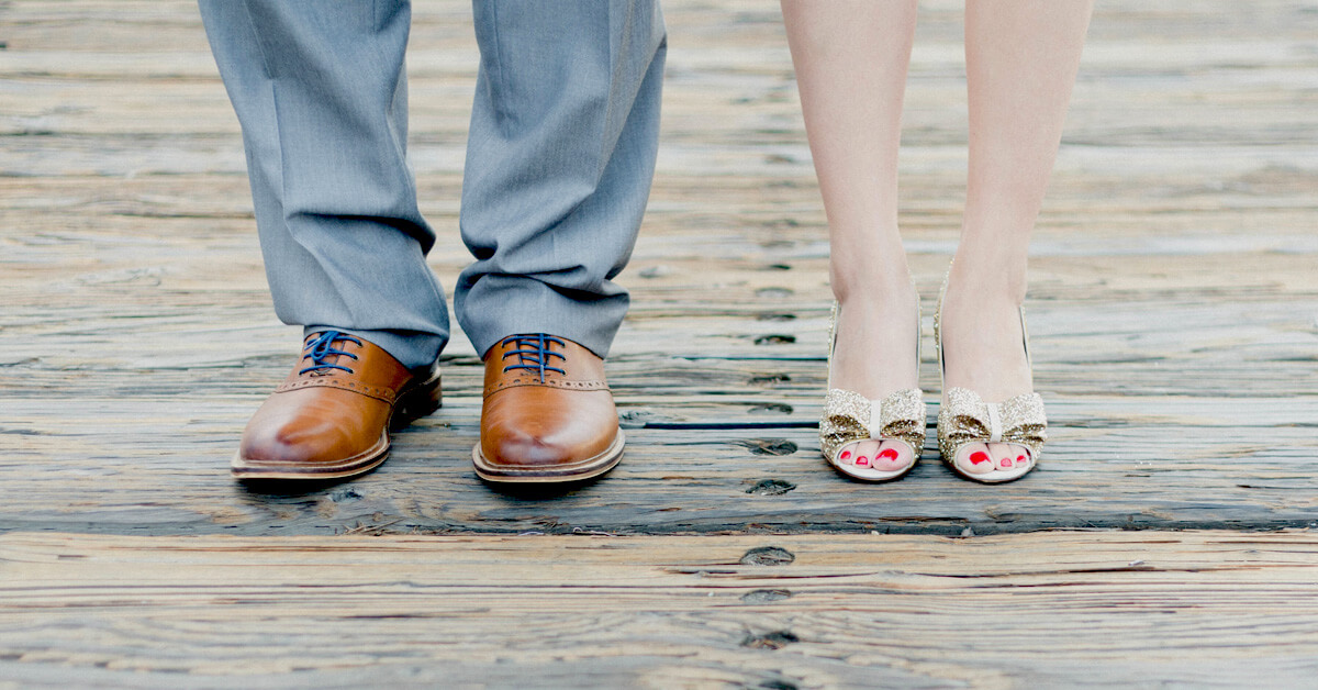 The feet of a couple standing together