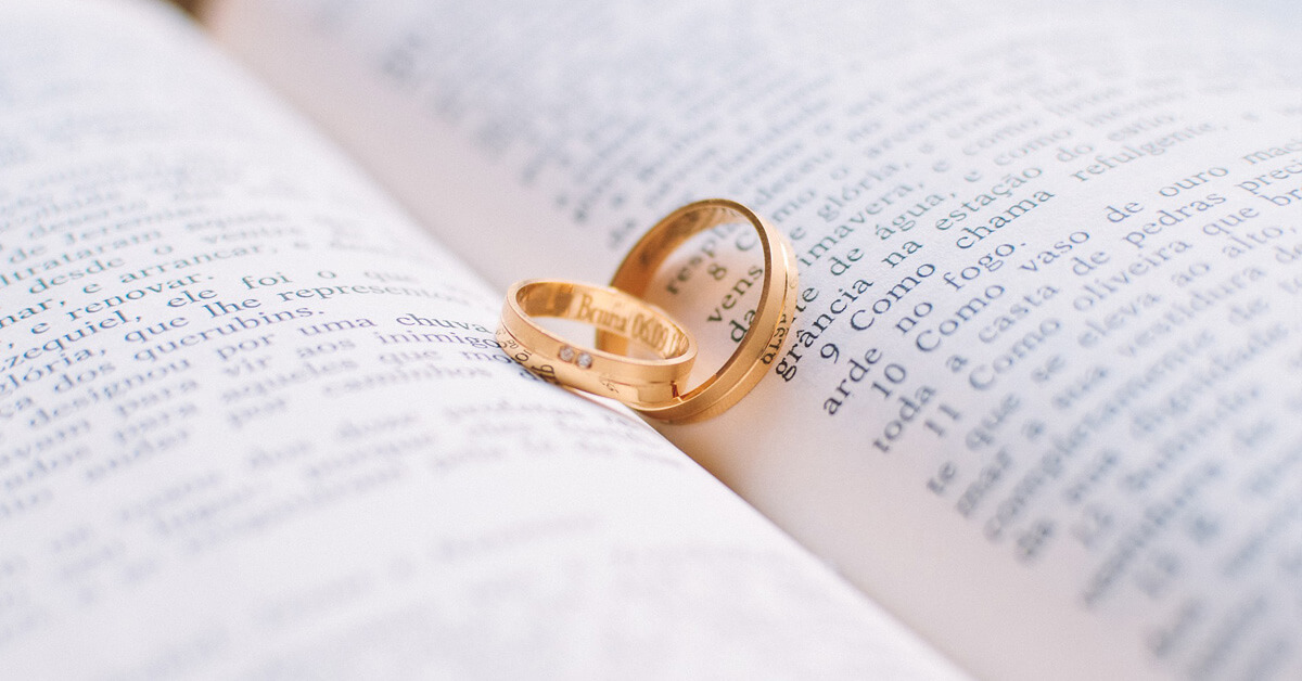 Wedding rings inside of a Bible