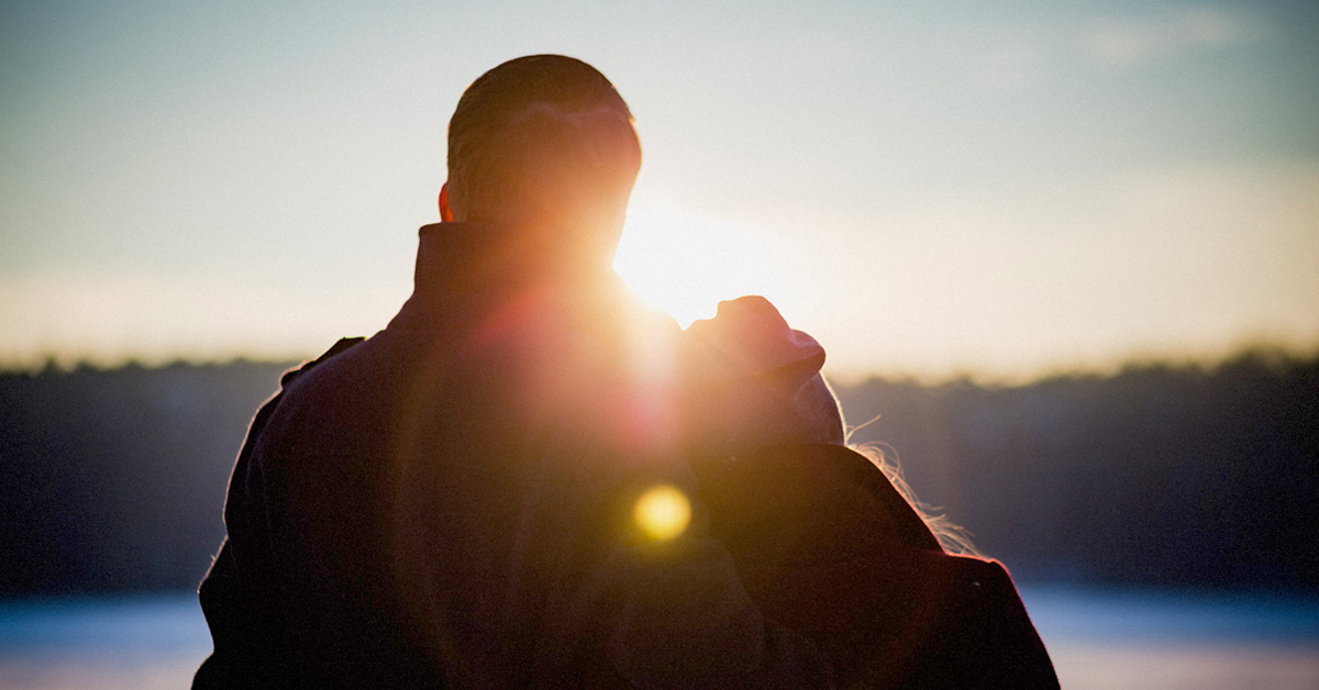 Couple standing in the sunlight