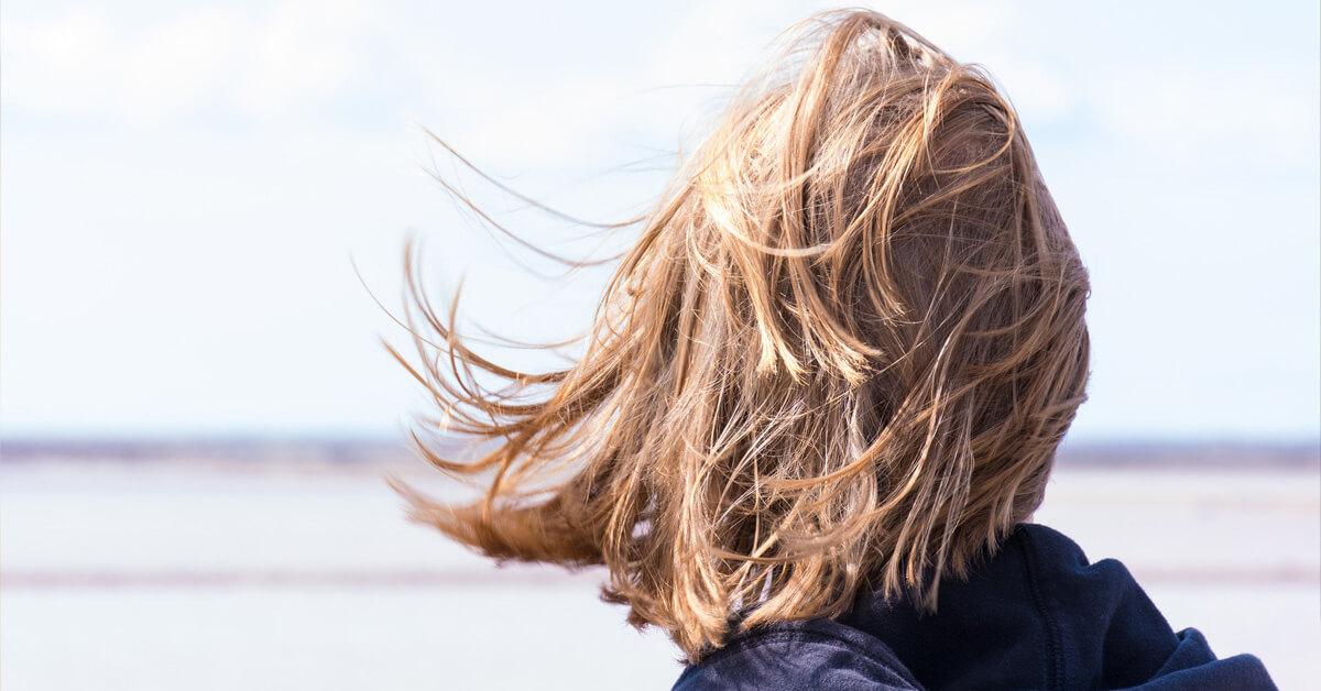 Woman looking away to the horizon