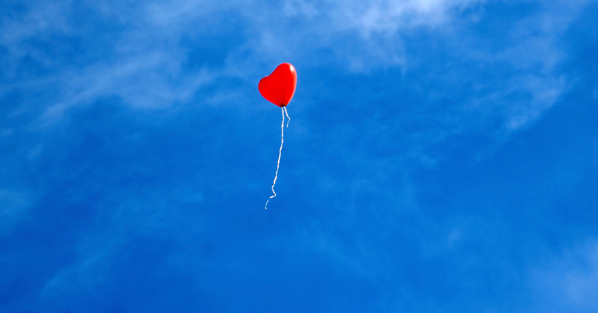 Heart balloon flying away