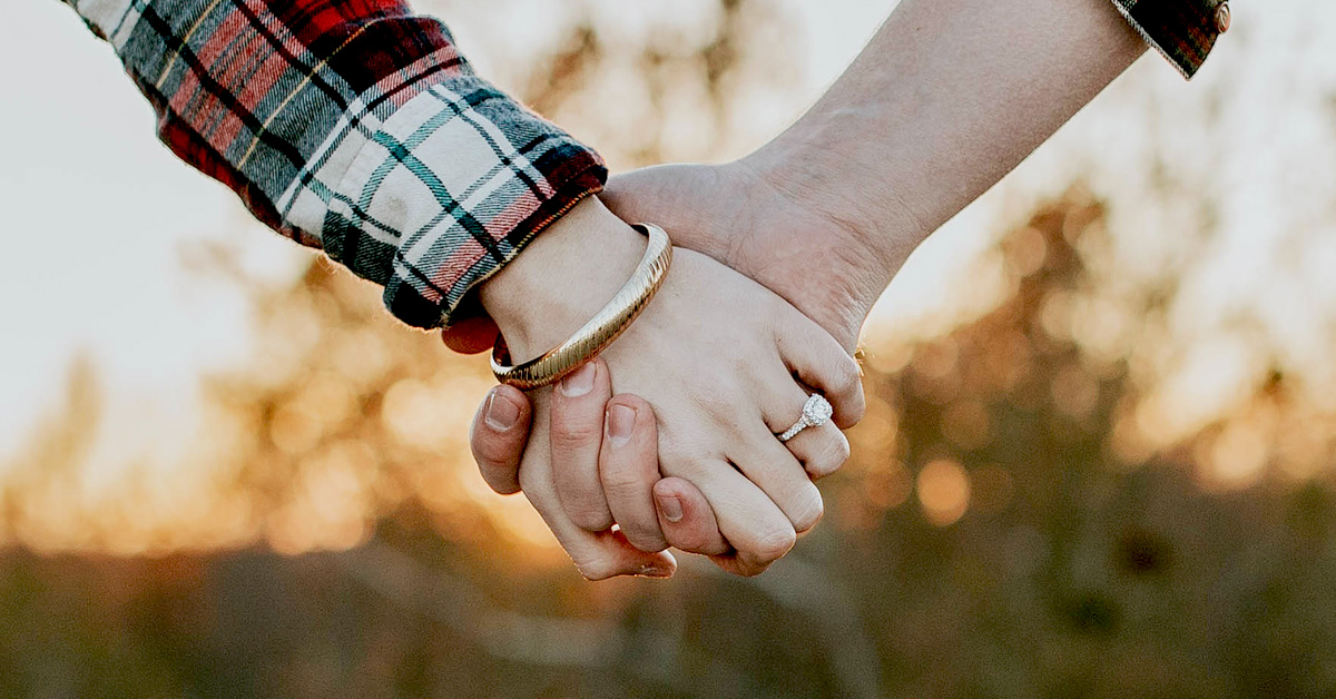 Couple holding hands with each other